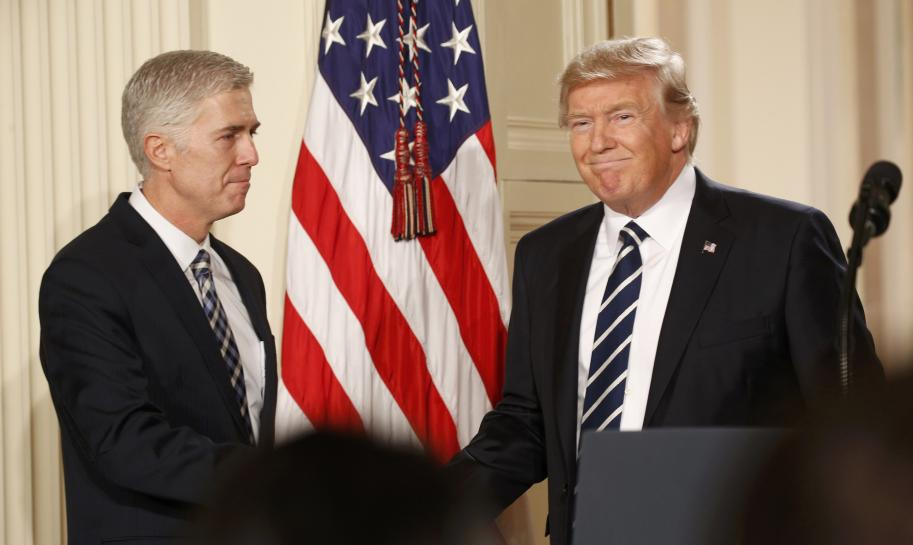 U.S. President Donald Trump shakes hands with Neil Gorsuch (L) after nominating him to be an associate justice of the U.S. Supreme Court at the White House in Washington, D.C., U.S., January 31, 2017.    REUTERS/Kevin Lamarque